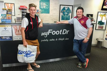 Adam Zampa from West End Redbacks with Greg Dower at my FootDr