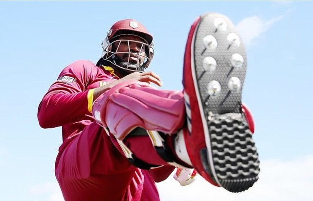 Chris Gayle (West Indies) showing off his brand new Custom Crickets Shoes